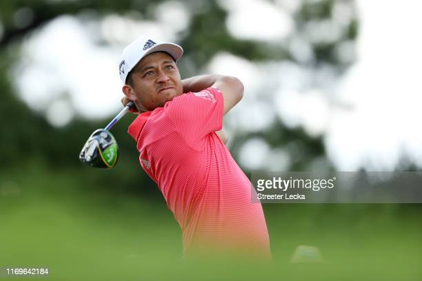 Xander Schauffele of the United States plays his shot from the 18th tee during the first round of the TOUR Championship at East Lake Golf Club on...