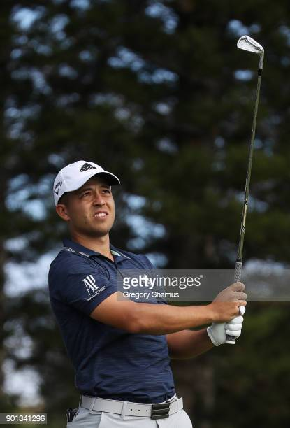 Xander Schauffele of the United States plays his shot from the second tee during the first round of the Sentry Tournament of Champions at Plantation...