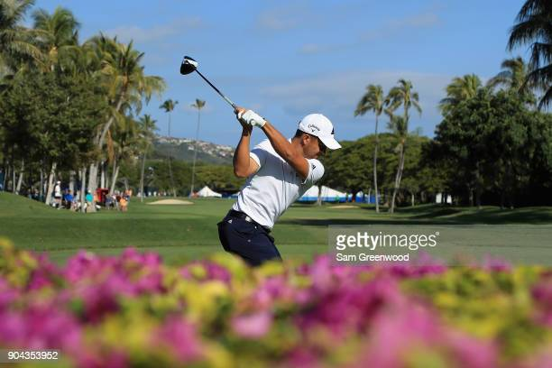 Xander Schauffele of the United States plays his shot from the tenth tee during round two of the Sony Open In Hawaii at Waialae Country Club on...