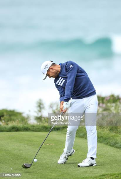 Xander Schauffele of the United States plays his tee shot on the par 4 11th hole during the first round of the 2019 USOpen at the Pebble Beach Golf...