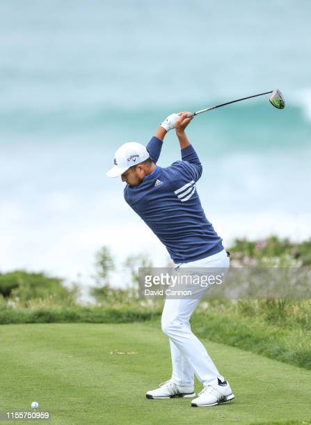 Xander Schauffele of the United States plays his tee shot on the par 4, 11th hole during the first round of the 2019 U.S.Open at the Pebble Beach...