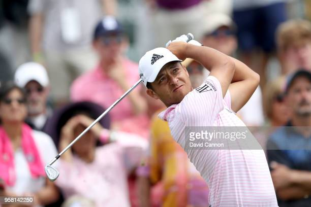 Xander Schauffele of the United States plays his tee shot on the par 3 third hole during the final round of the THE PLAYERS Championship on the...