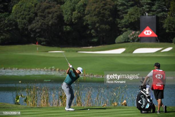 Xander Schauffele of the United States plays his third shot on the sixth hole during the third round of the WGC HSBC Champions at Sheshan...