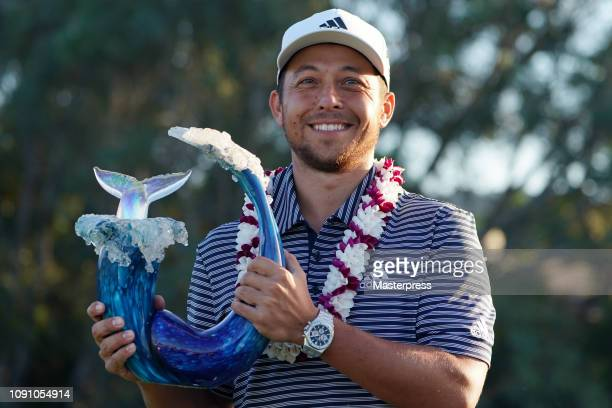 Xander Schauffele of the United States poses with the trophy after winning the Sentry Tournament of Champions at the Plantation Course at Kapalua...
