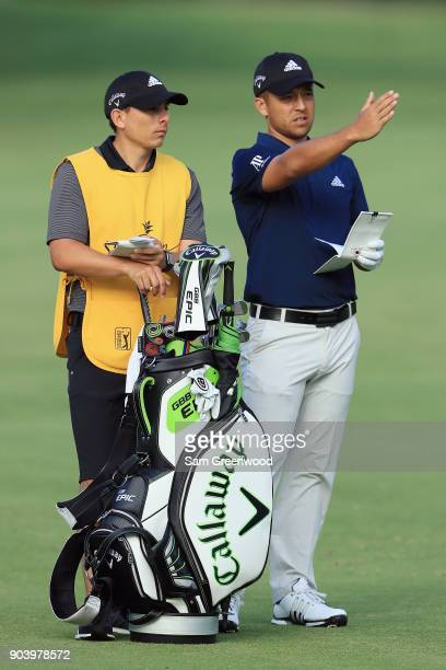 Xander Schauffele of the United States prepares to play a shot on the 15th hole during round one of the Sony Open In Hawaii at Waialae Country Club...