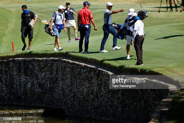 Xander Schauffele of the United States prepares to take a drop on the 15th hole after hitting into the hazard during the final round of the Charles...