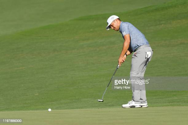 Xander Schauffele of the United States putts on the 12th green during the final round of the Sentry Tournament Of Champions at the Kapalua Plantation...