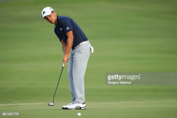 Xander Schauffele of the United States putts on the 18th green during the first round of the Sentry Tournament of Champions at Plantation Course at...