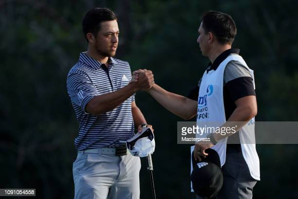 Xander Schauffele of the United States reacts after the final round of the Sentry Tournament of Champions at the Plantation Course at Kapalua Golf...