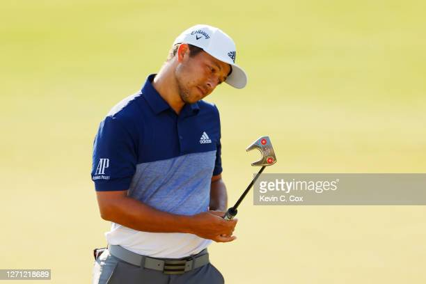 Xander Schauffele of the United States reacts on the 18th green during the final round of the TOUR Championship at East Lake Golf Club on September...