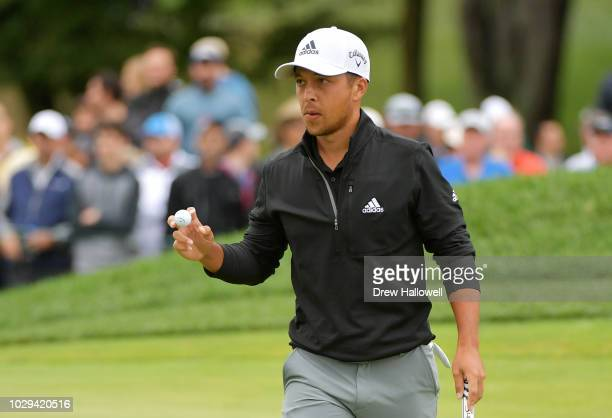 Xander Schauffele of the United States reacts on the eighth green during the third round of the BMW Championship at Aronimink Golf Club on September...