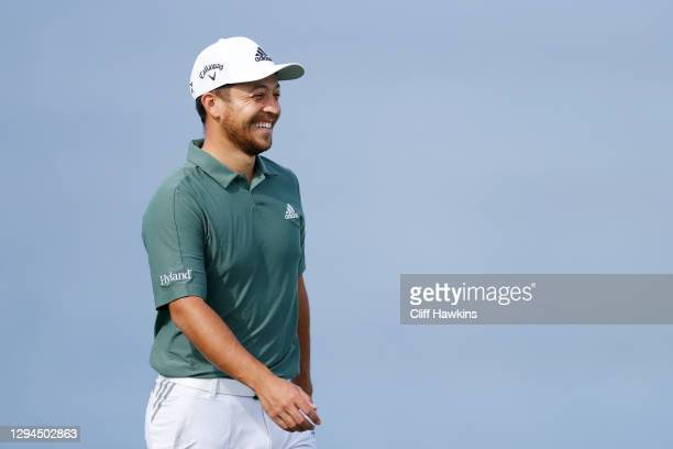 Xander Schauffele of the United States reacts on the tenth green during a practice round prior to the Sentry Tournament Of Champions on the...