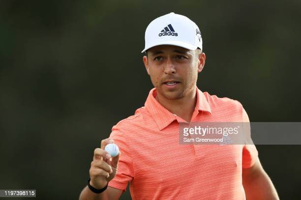 Xander Schauffele of the United States reacts to his birdie on the 18th green during the second round of the Sentry Tournament Of Champions at the...