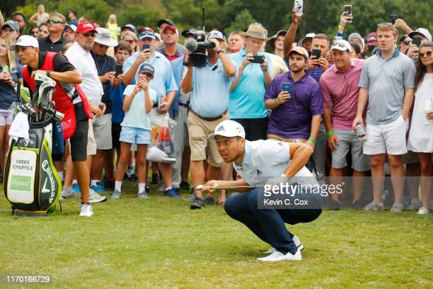 Xander Schauffele of the United States reacts to his shot on the eighth hole during the final round of the TOUR Championship at East Lake Golf Club...