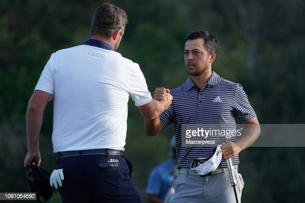 Xander Schauffele of the United States shakes hands with Marc Leishman of Australia after the final round of the Sentry Tournament of Champions at...