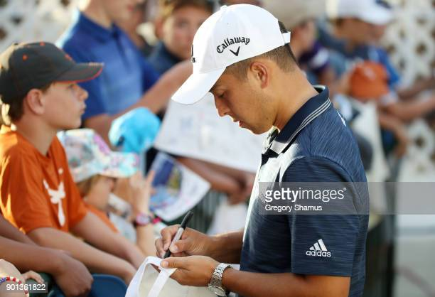 Xander Schauffele of the United States signs autographs during the first round of the Sentry Tournament of Champions at Plantation Course at Kapalua...