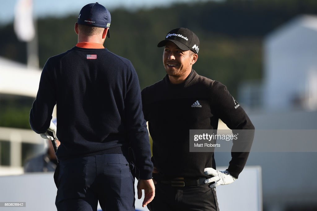 Xander Schauffele of the United States speaks with Daniel Berger of the United States during the second round of the CJ Cup at Nine Bridges on October 20, 2017 in Jeju, South Korea.
