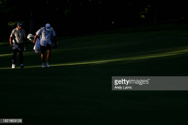 Xander Schauffele of the United States walk up the ninth fairway with his caddie during the second round of The Memorial Tournament at Muirfield...