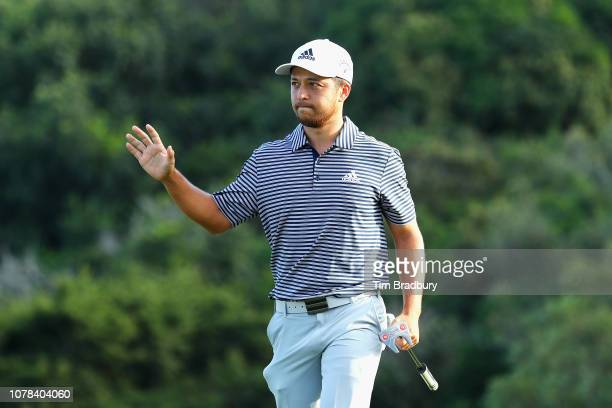 Xander Schauffele of the United States waves to the crowd after making a putt for birdie on the 18th green to win the Sentry Tournament of Champions...