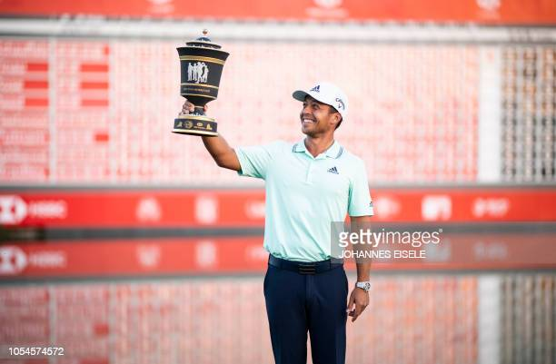 Xander Schauffele of the US poses with the trophy after winning the WGC-HSBC Champions golf tournament in Shanghai on October 28, 2018.