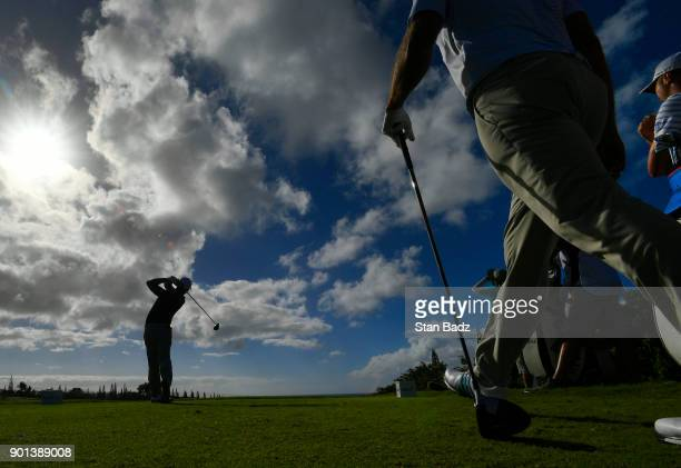 Xander Schauffele plays a tee shot on the 12th hole during the first round of the Sentry Tournament of Champions at Plantation Course at Kapalua on...