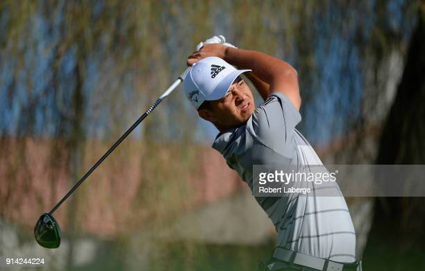 Xander Schauffele watches his tee shot on the second hole during the final round of the Waste Management Phoenix Open at TPC Scottsdale on February 4...