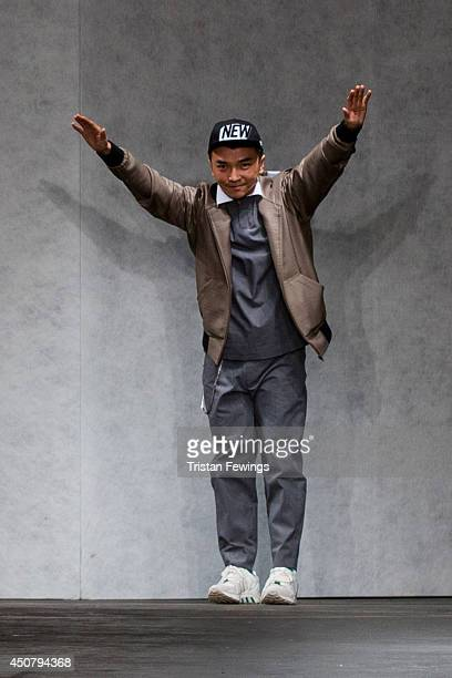 Xander Zhou on the runway at the Xander Zhou show during the London Collections Men SS15 on June 17 2014 in London England