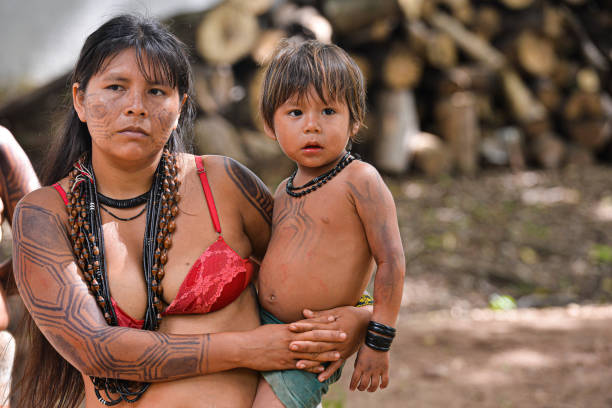 Xavante indigenous woman holding her son
