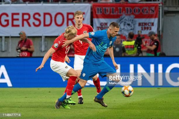 Xaver Schlager and Martin Hinteregger of Austria and Josip Ilicic of Slovenia compete for the ball during the UEFA Euro 2020 Qualifier match between...