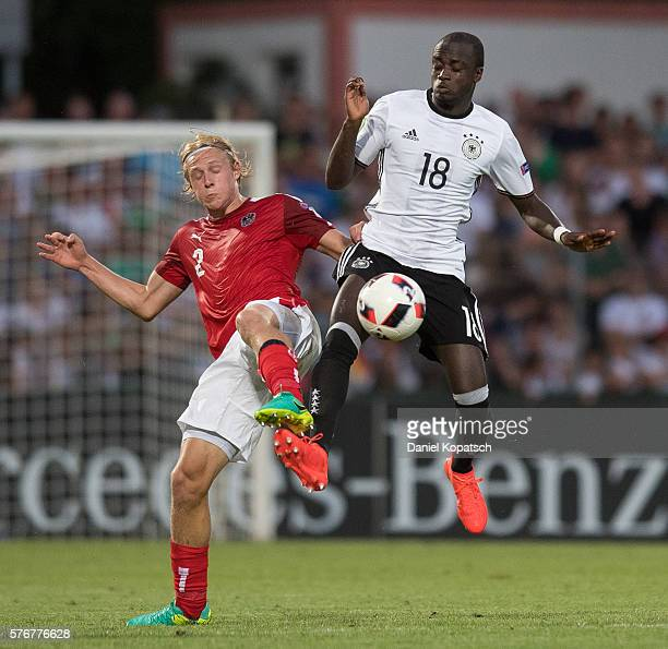 Xaver Schlager of Austria is challenged by Amara Conde of Germany during the UEFA Under19 European Championship match between U19 Germany and U19...