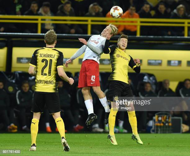 Xaver Schlager of Salzburg and Marco Reus of Dortmund battle for the ball during UEFA Europa League Round of 16 match between Borussia Dortmund and...