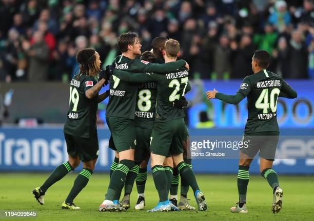 Xaver Schlager of VfL Wolfsburg celebrates with his team mates after scoring his team's first goal during the Bundesliga match between VfL Wolfsburg...