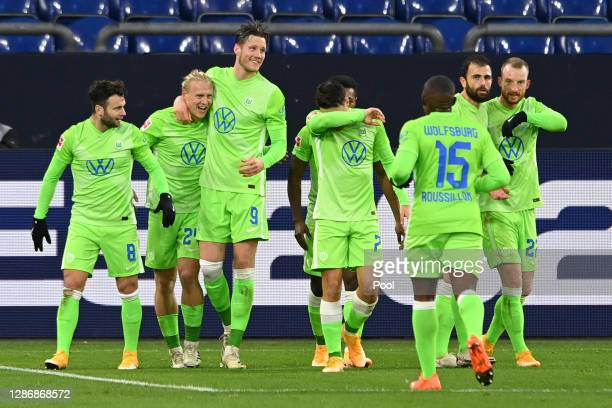 Xaver Schlager of VfL Wolfsburg celebrates with teammates after scoring his team's second goal during the Bundesliga match between FC Schalke 04 and...