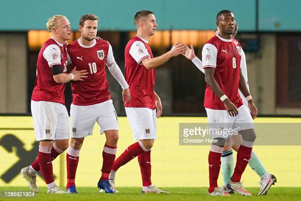Xaver Schlager, Reinhold Ranftl, David Alaba and Louis Schaub of Austria celebrate victory after the UEFA Nations League group stage match between...