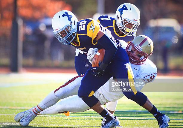 Xaverian Brothers High School junior Coby Tippett is tackled by Boston College High School senior Scott Gosnell Boston College High School's football...