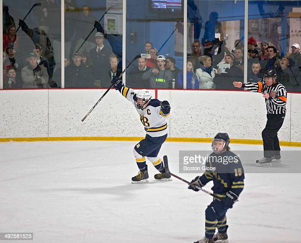 Xaverian Brothers Ricky Smith celebrates his game winning goal as he skates past Arch Bishop Williams Mike Jessman during double overtime at Stoneham...