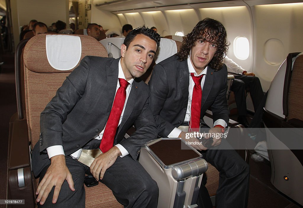 Xavi Alonso (L) and Carles Puyol of Spain look on shortly after touch down at Johannesburg airport on June 11, 2010 in Johannesburg, South Africa.