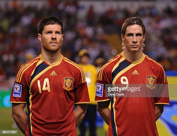 Xavi Alonso and Fernando Torres of Spain line-up before the Group 5 FIFA2010 World Cup Qualifier match between Spain and Belgium at the Riazor...