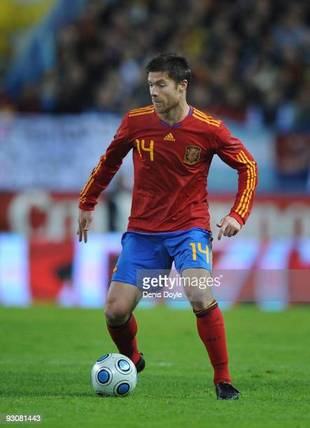 Xavi Alonso of Spain in action during the International friendly match between Argentina and Spain at the Vicente Calderon stadium on November 14...