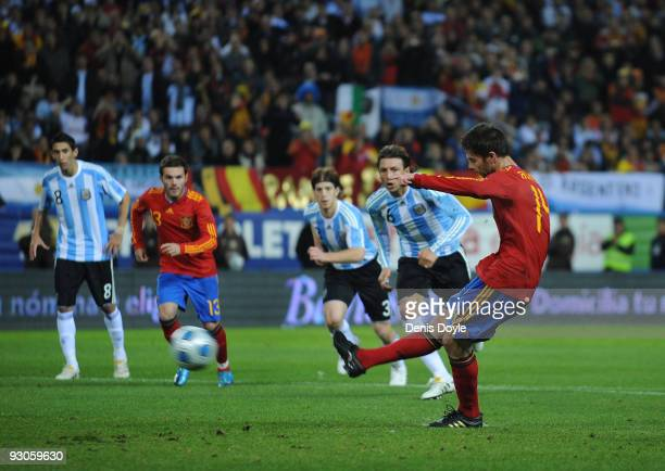 Xavi Alonso of Spain scores a penalty during the International friendly match between Argentina and Spain at the Vicente Calderon stadium on November...