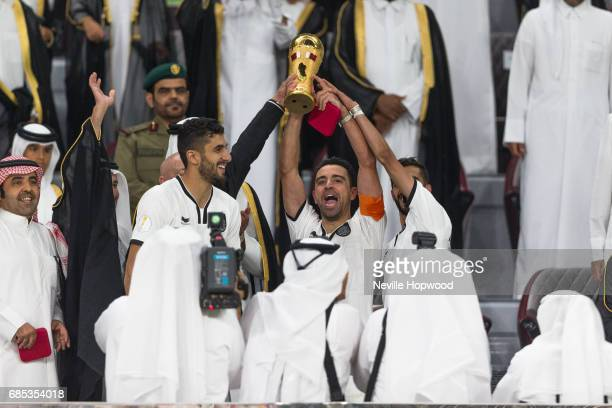 Xavi captain of Al Sadd celebrates winning the 2017 Emir Cup at Khalifa International Stadium on May 19 2017 in Doha Qatar Qatar's Supreme Committee...