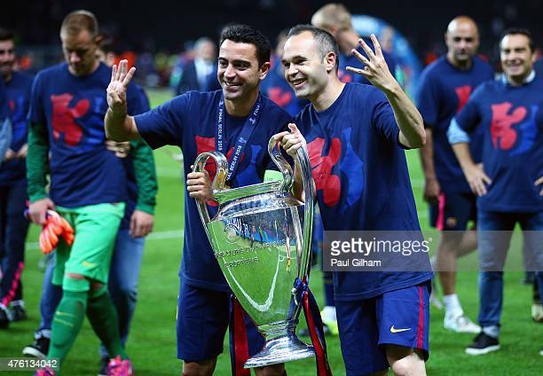 Xavi Hernandez and Andres Iniesta of Barcelona celebrate with the trophy after the UEFA Champions League Final between Juventus and FC Barcelona at...