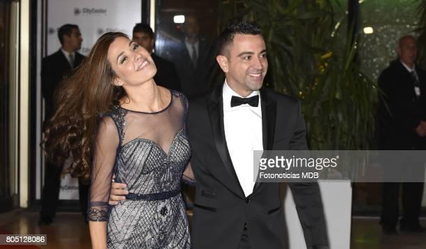 Xavi Hernandez and Nuria Cunillera attend Lionel Messi and Antonela Rocccuzzo's wedding at the City Center Rosario Hotel Casino on June 30 2017 in...