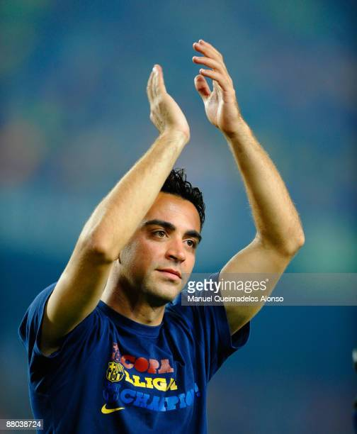 Xavi Hernandez celebrates at the Nou Camp stadium the day after Barcelona won the UEFA Champions League Cup final on May 28 2009 in Barcelona Spain...