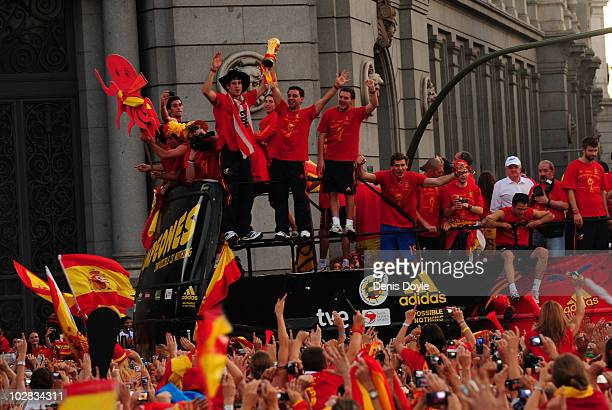 Xavi Hernandez holds aloft the FIFA World Cup to the crowds gathered in Plaza Cibeles on July 12, 2010 in Madrid, Spain after Spain won the FIFA...