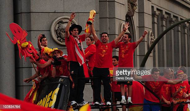 Xavi Hernandez holds aloft the FIFA World Cup to the crowds gathered in Plaza Cibeles on July 12 2010 in Madrid Spain after Spain won the FIFA World...