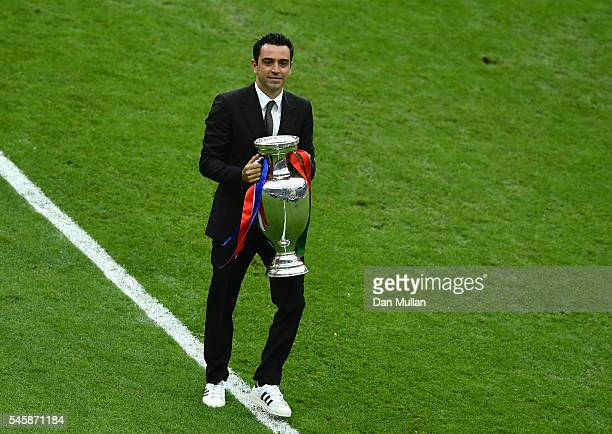 Xavi Hernandez holds the Henri Delaunay trophy prior to the UEFA EURO 2016 Final match between Portugal and France at Stade de France on July 10 2016...