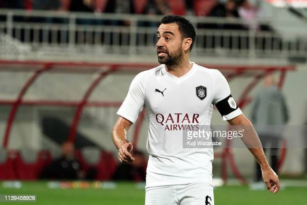 Xavi Hernandez of Al Sadd in action during the Qatar Stars League match between Al Duhail and Al Sadd at the Abdullah bin Khalifa Stadium on March 30...