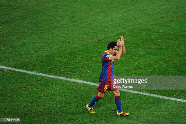Xavi Hernandez of Barcelona acknowledges the crowd as he leaves the field during the La Liga match between Barcelona and Real Sociedad at Camp Nou...
