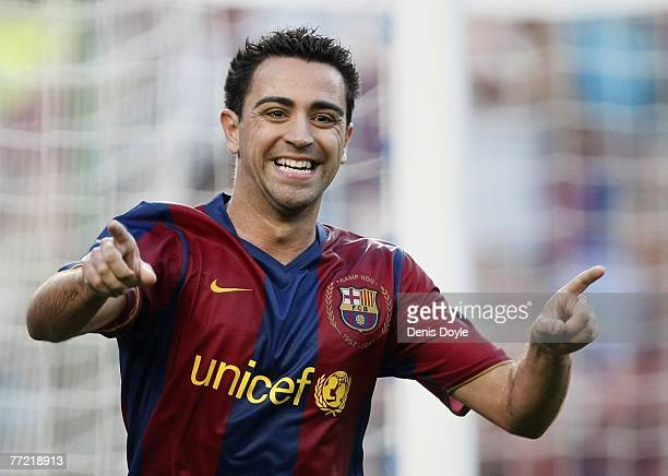 Xavi Hernandez of Barcelona celebrates after scoring Barcelona's third goal during the Primera Liga match between Barcelona and Atletico de Madrid at...